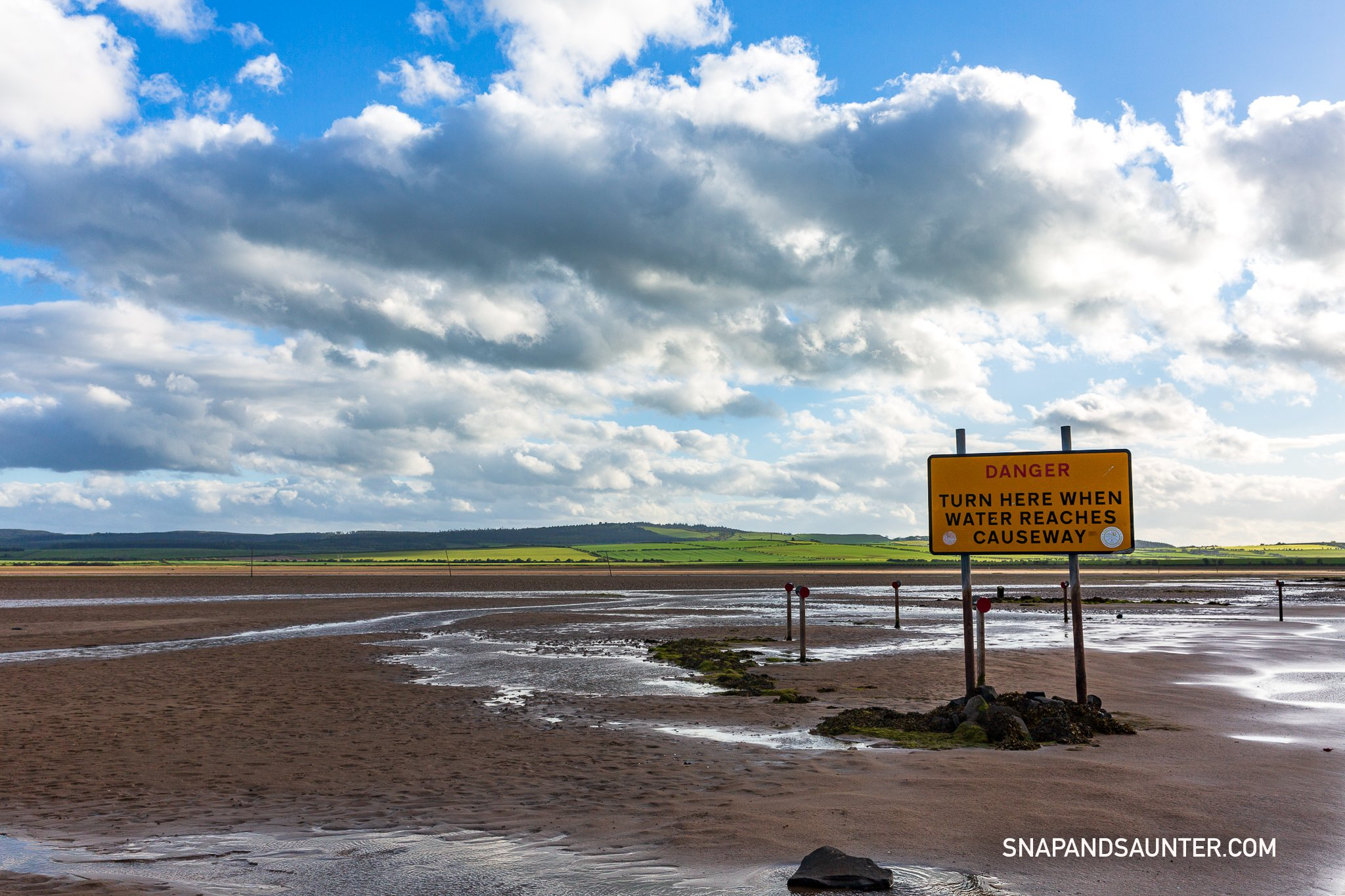 warning tidal sign at the crossing for Holy Island