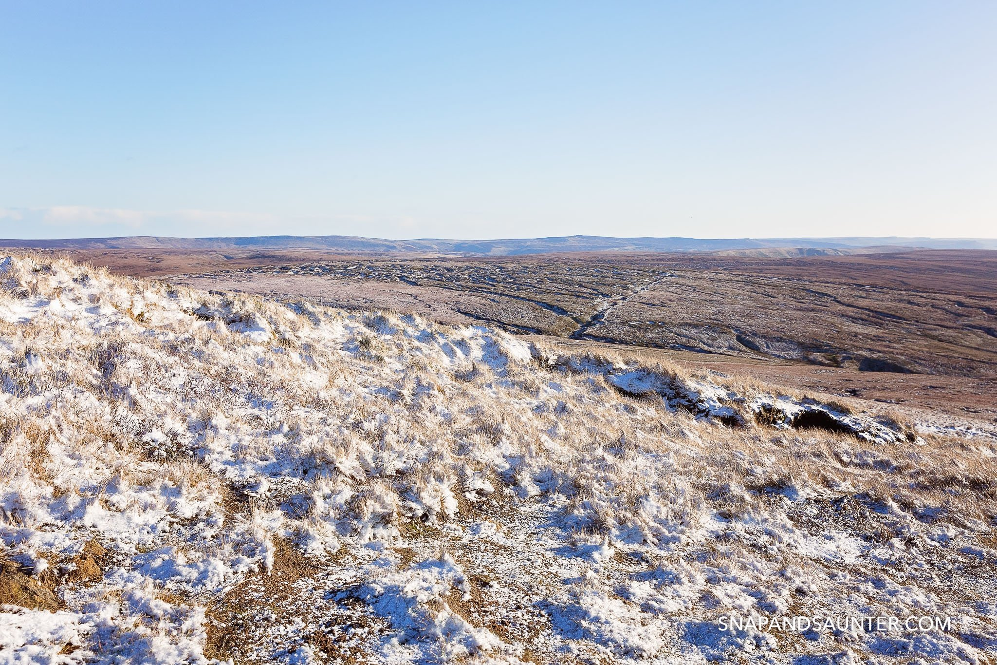 A view from Higher Shelf Stone summit in winter in Bleaklow