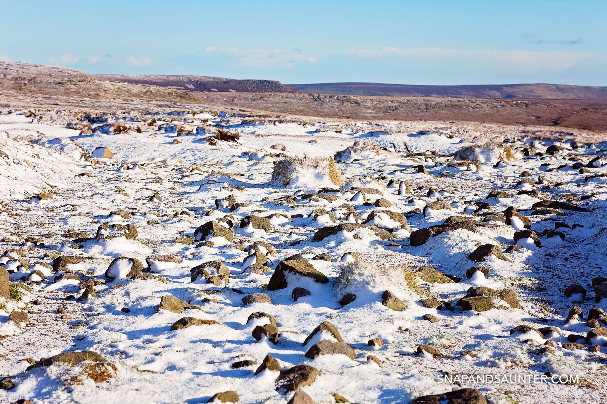 rocks covered in snow in Bleaklow in Derbyshire part of the Peak District