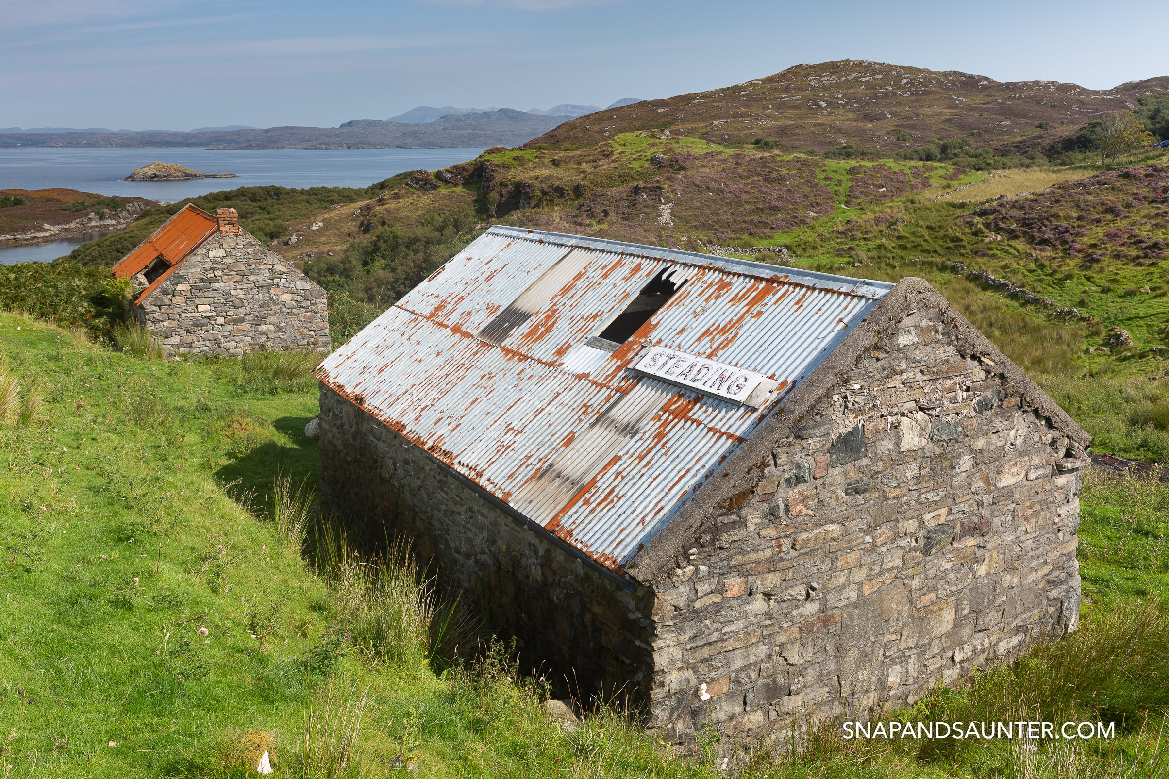 Two barns next to the Drumbeg Viewpoint on route North Coast 500 in the Scottish Highlands
