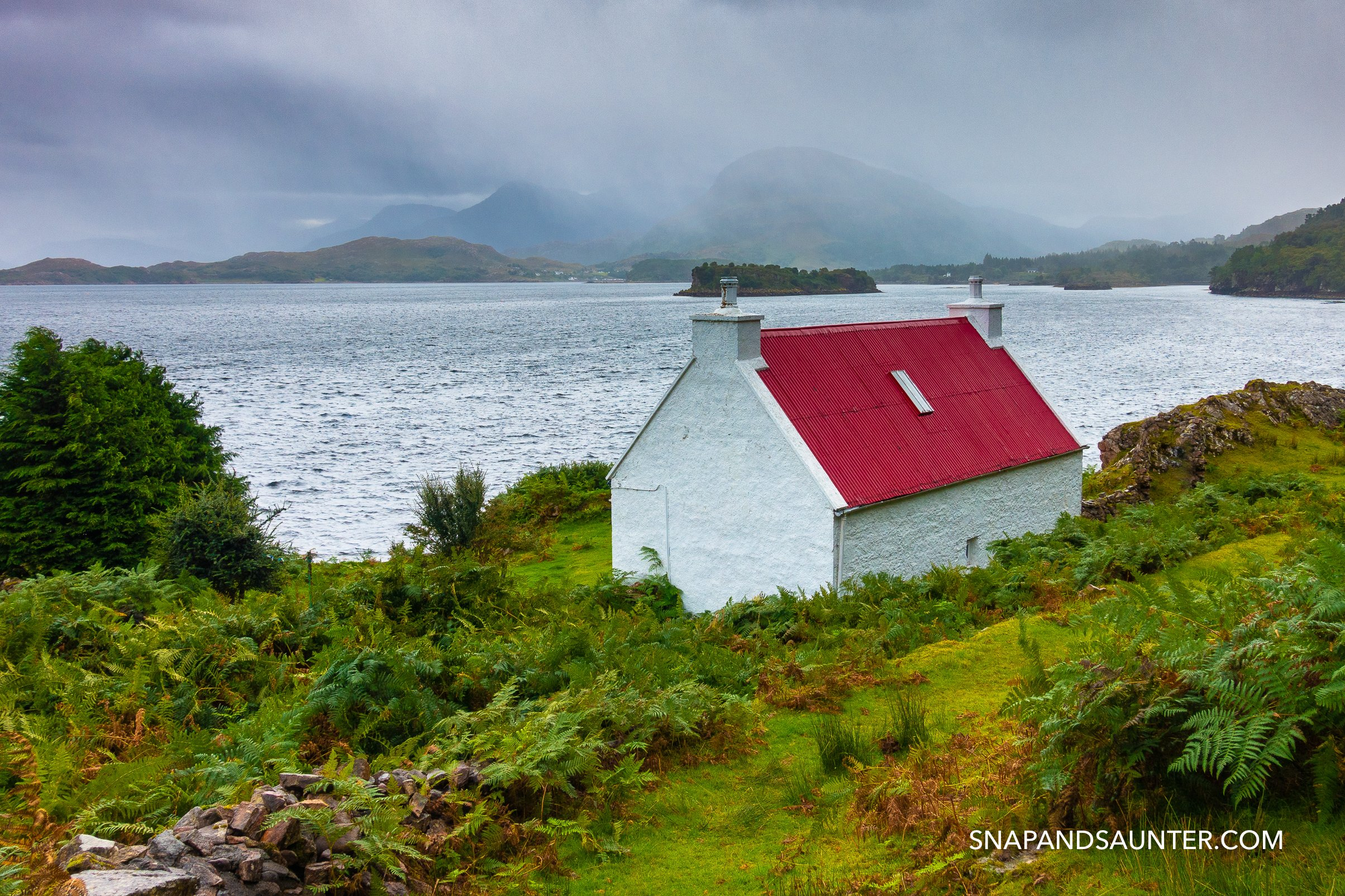 cottage with red roof in Shieldag with Loch Shieldag in background on route NC 500 route