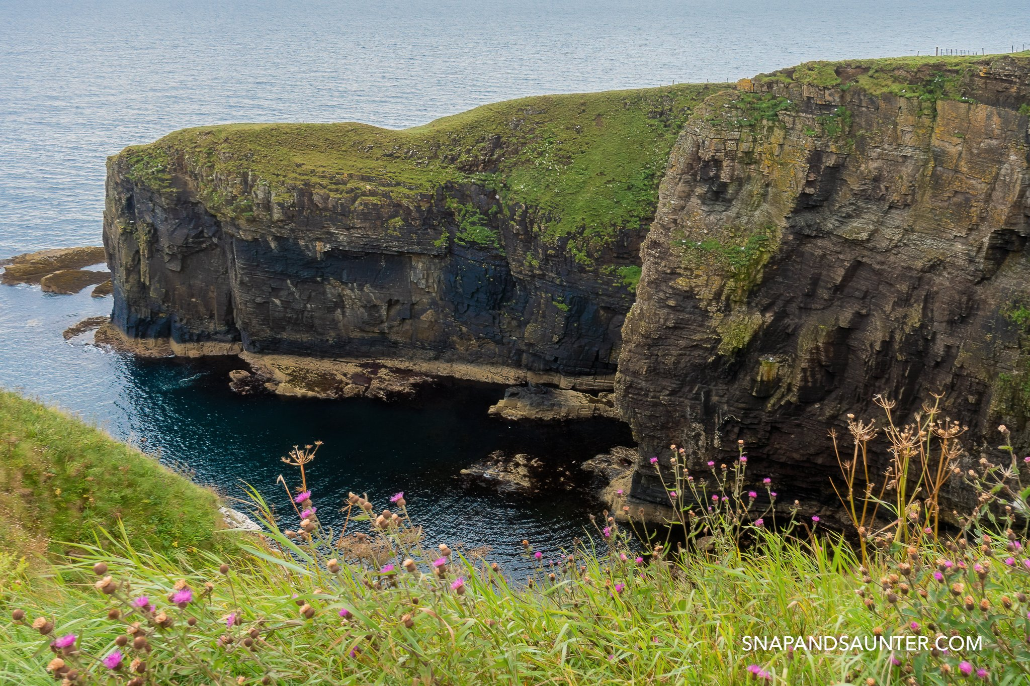 Cliffs at Whaligoe Steps on the North Coast 500 route. Martina Hardiman Photography.