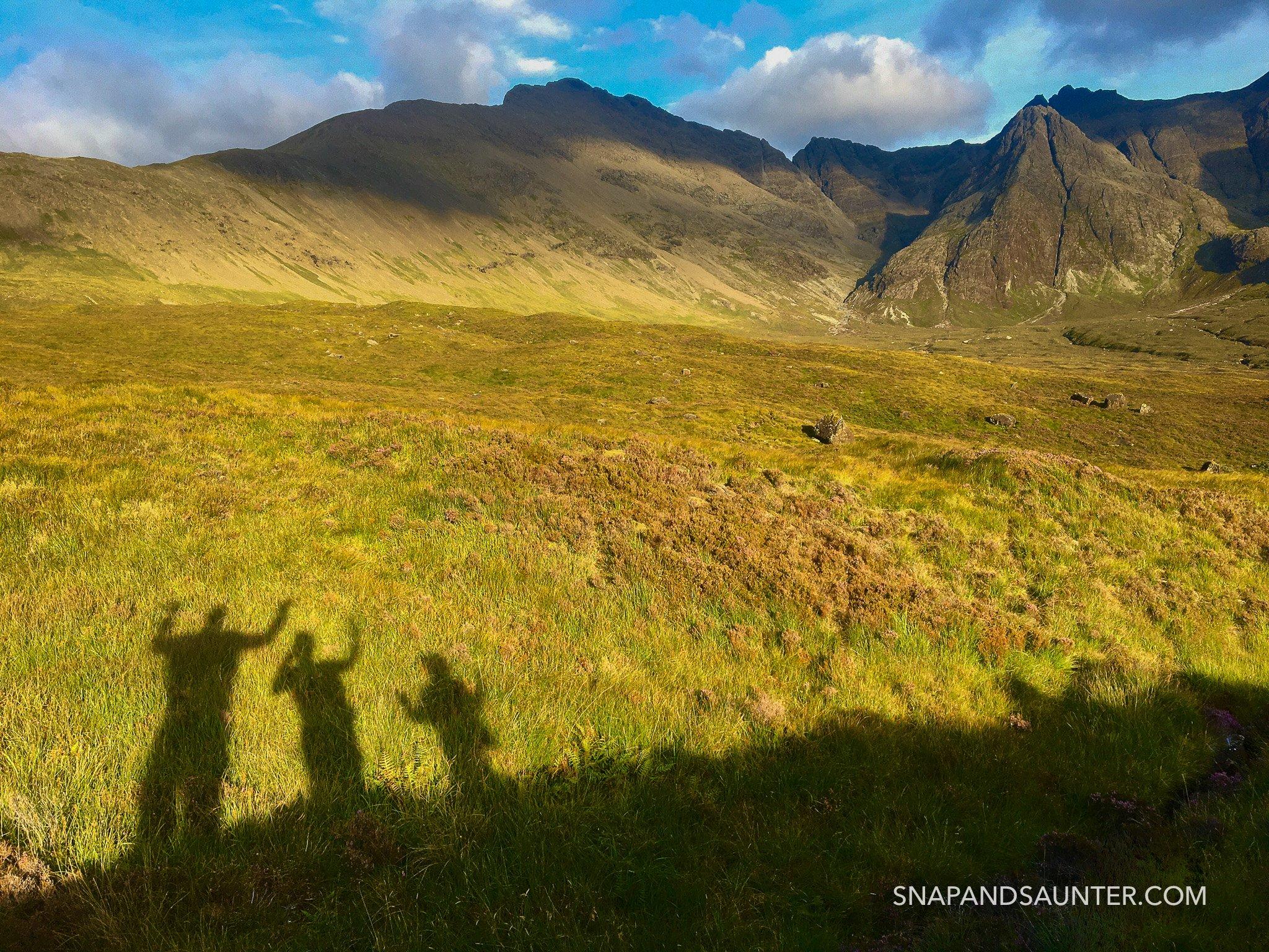 People shadows at Fairy Pools, Isle of Skye